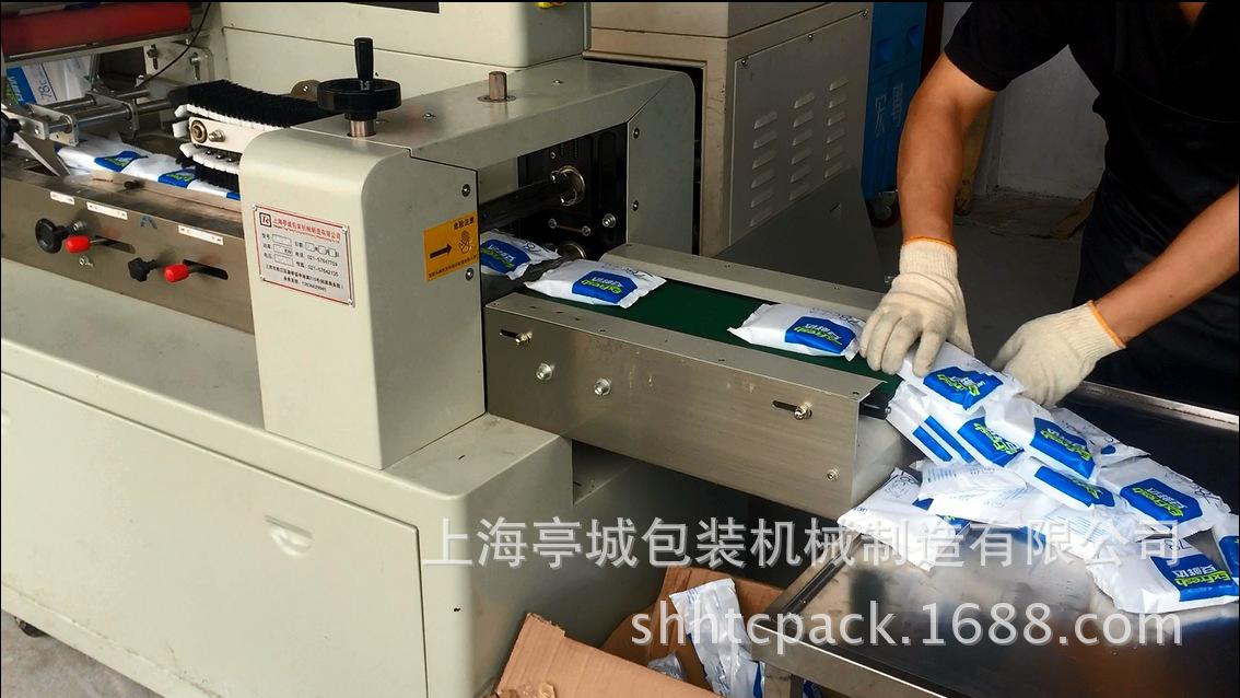 直销暖宝宝 刀叉勺枕式高速包装机 实验容器 注射器全自动包装机示例图14